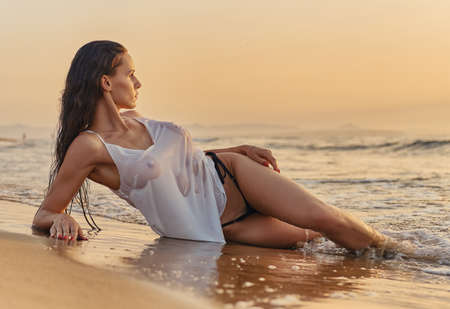 Photo for Sexy millennial single woman pose on beach near sea. Beauty and fashion, travel and vacation summer holidays, sexy slim girls with perfect body and summertime collection, fitness bikini model concept - Royalty Free Image