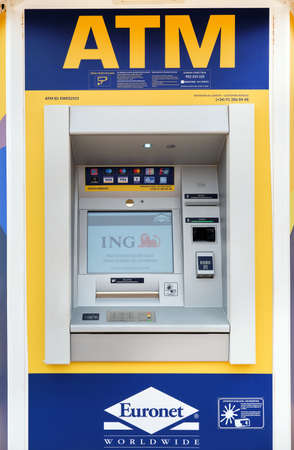 Photo pour Spain - February 21, 2021: Automated teller machine (ATM) Euronet Worldwide American worldwide provider of e payments services. Financial services, electronic funds transfer, retail services concept - image libre de droit
