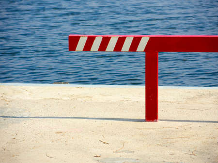 Barrier on the pier warning hit the water