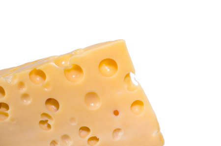 Piece of cheese with heart shape holes isolated white