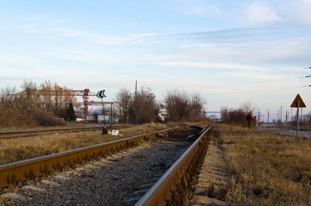 The railway passing through an industrial zone
