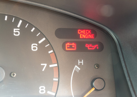 Car dashboard warning lights symbols showing check engine ,oil pressure , battery charge