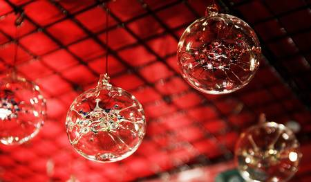 Christmas ornaments glas orbs in front of red background