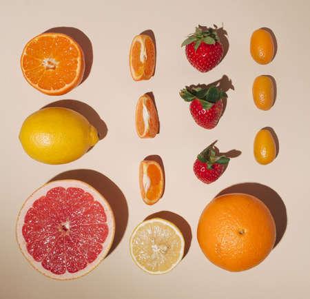 Photo for Creative layout made of fruits,flat lay,lemon,orange,tangerin,fortunella,strawberry,pink grapefruit on the pastel background - Royalty Free Image