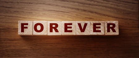 Photo pour FOREVER word on wooden cubes on wooden Floor. Eternal love or trustworthy business longterm relationship concept. - image libre de droit