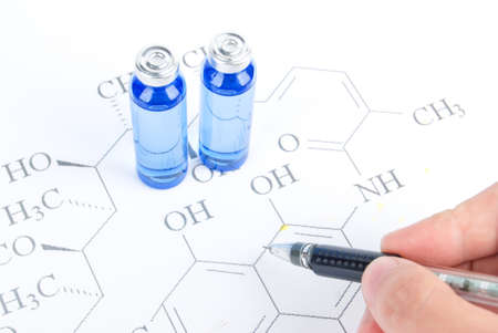 Pen and medicine on chemical formula