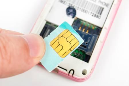 Photo pour Sim card with cellphone - image libre de droit