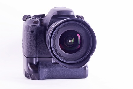 digital single lens reflex camera with zoom lense isolated on white
