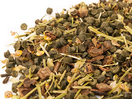 Diet muesli  with herbs background for horse