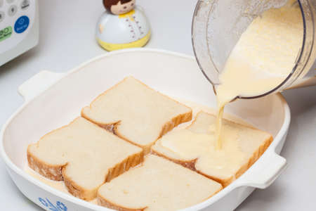 French toast preparation: Soaking bread in the mix for french toast preparation