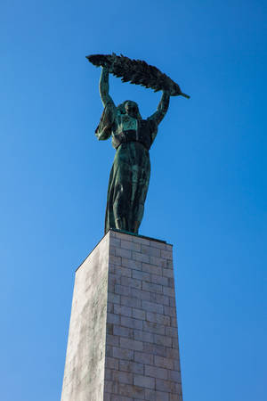 The Liberty Statue or Freedom monument located on the Gellert Hill in Budapest
