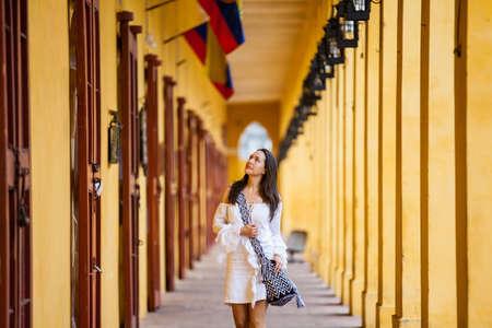 Beautiful woman walking around the walled city in Cartagena de Indias