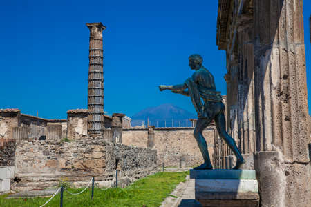 Photo for Ruins of the ancient Temple of Apollo with bronze Apollo statue in Pompeii - Royalty Free Image