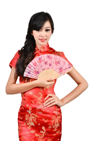 Photo pour pretty women with Chinese traditional dress Cheongsam and hole Chinese Fan on white background - image libre de droit