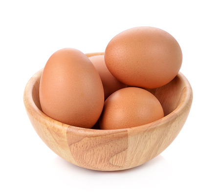 eggs in a wooden bowl isolated on white background
