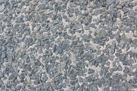 Texture of a wall lined with granite rubble