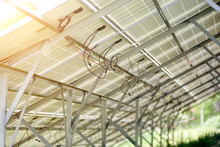 Photo pour Interior of stand-alone photo voltaic solar system secured on metal rear legs lit by summer sun. Alternative energy, ecology and environment protection and cheap electricity production concept. - image libre de droit
