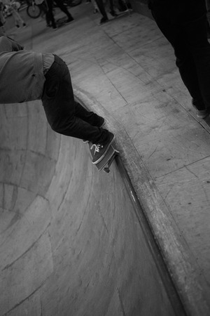 Grind by skateboard in closed sport park. Black and white picture with extreme concept.