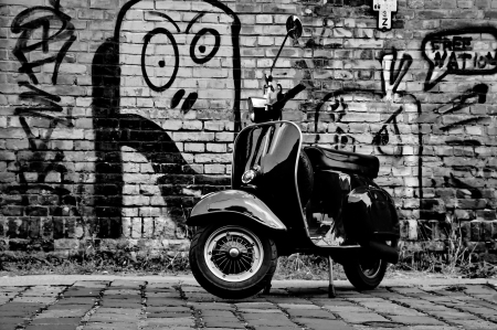 Scooter in front of a wall