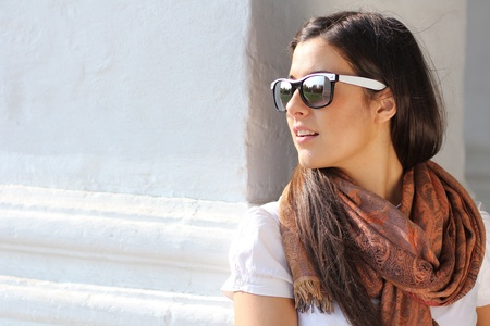 Beautiful young woman in sunglasses. Outdoor portrait