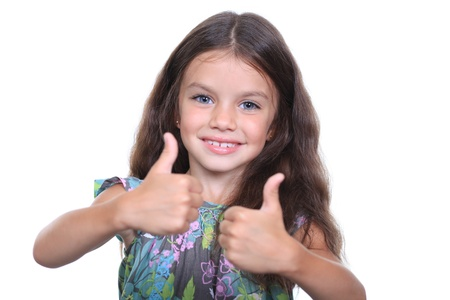 Beautiful little girl shows finger as sign that everything is fine