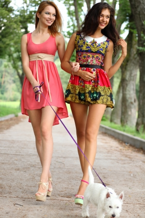 Two cheerful girls in the street