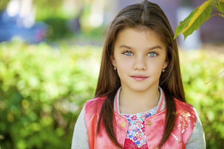 Beautiful Happy little girl outdoors