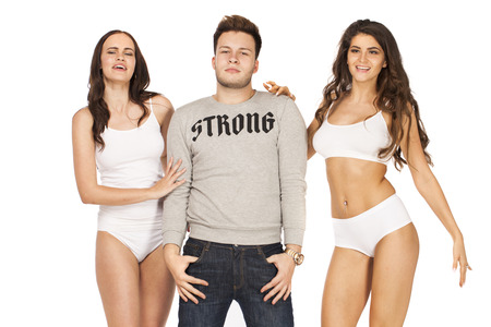 Photo pour One guy and two sexy girls, isolated on white background - image libre de droit