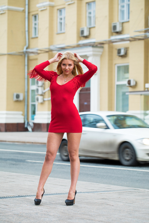 Photo pour Portrait close up of young beautiful blonde woman in red sexy dress, spring street outdoors - image libre de droit
