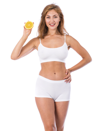 Photo for Orange diet. Young beautiful blonde woman in fitness clothing, isolated on white background - Royalty Free Image