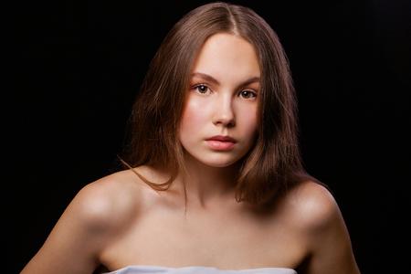 Photo pour Close up Make up fashion model. Young beautiful brunette girl, on studio black wall background - image libre de droit