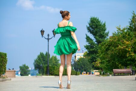 Photo for Full body sexy woman. Young beautiful brunette girl walks along the embankment of the river Volga in Samara - Royalty Free Image