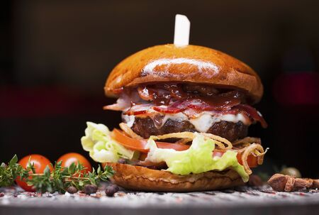 Photo for Fast food closeup with traditional tasty hamburger - Royalty Free Image