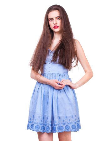 Photo pour Close up portrait of a young beautiful happy brunette woman in blue dress, isolated on white background - image libre de droit