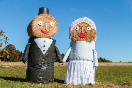 Marriage Tradition in Bavaria  Lovely Bridal Couple Puppets made out of Hay Bale with Suit and Wedding Dress in Europe in Autumn