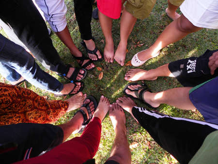 A GROUP OF FEET FORM CIRCLE