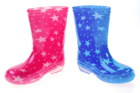 Pink and blue Wellington bootsの写真素材
