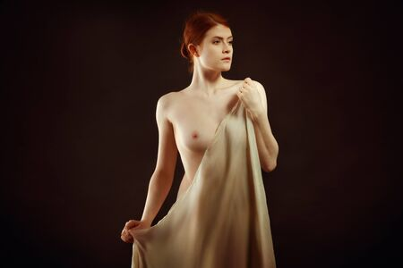 Photo for Young beauty covering her body with a cloth - Royalty Free Image
