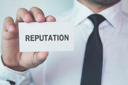 Photo pour Businessman showing word Reputation on business card. - image libre de droit