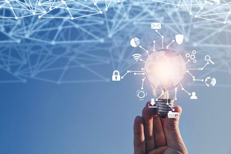 Foto de Internet network with creative light bulb. Business technology concept - Imagen libre de derechos