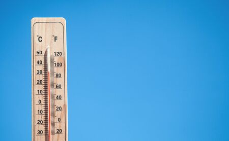 Photo for Thermometer on blue sky background. - Royalty Free Image