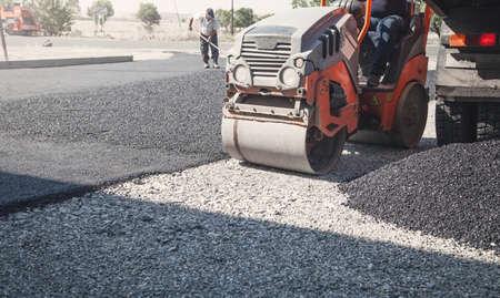Photo for Asphalt roller stacking and pressing hot asphalt. - Royalty Free Image