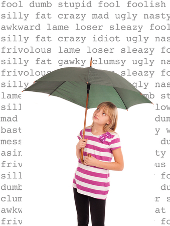 Girl defending against hurtful words with an umbrella.