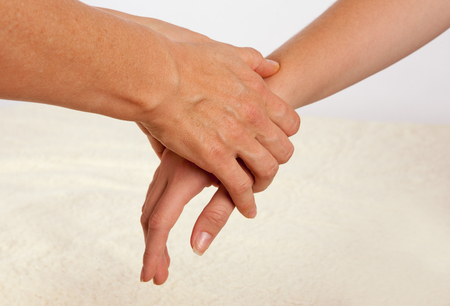Photo for Bowen massage treatment of a hand. - Royalty Free Image