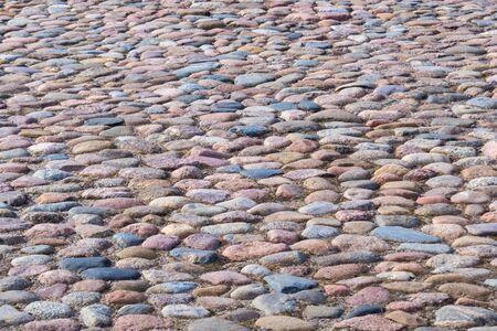 Historic cobblestone pavement, top view, stone road texture