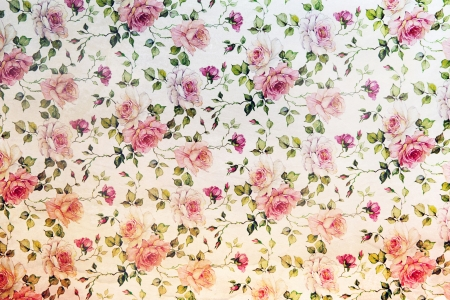 Vintage pink roses wallpaper in a repeat background pattern with flowers and trailing leaves