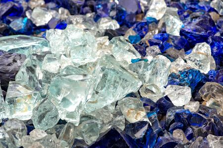 Pieces of white and blue raw glass
