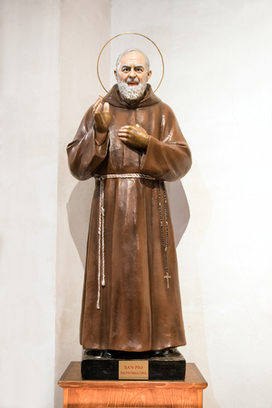 Statue of Padre Pio or Saint Pio of Pietrelcina, a Roman Catholic friar and priest who displayed Holy Stigmata throughout his life, with his hand raised in benediction