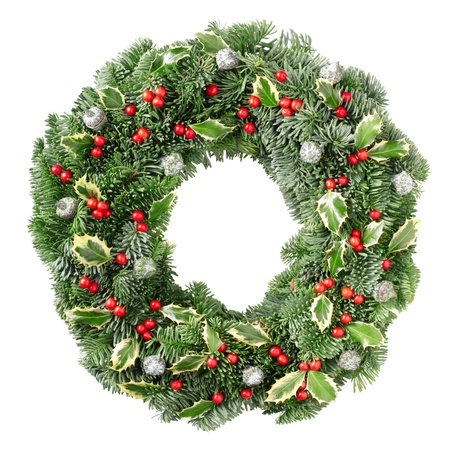 Christmas pine wreath and holly isolated on white background