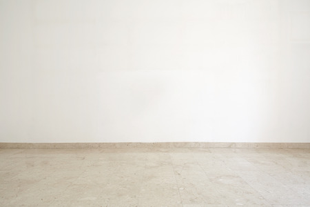 Empty room with marble floor and white wall